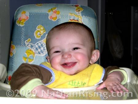 Happy in his high chair